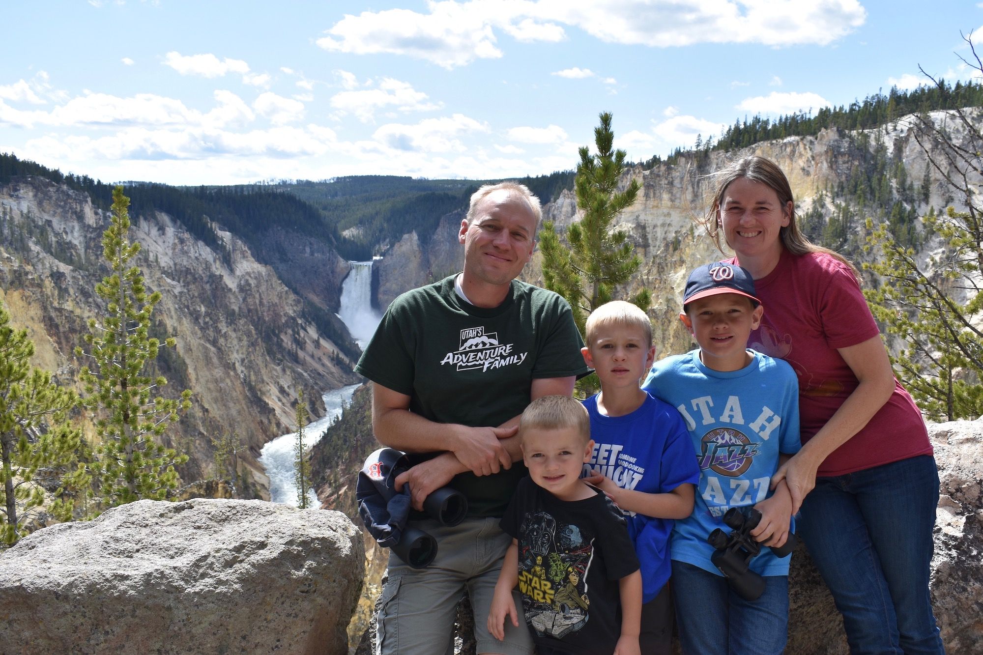 family by lower falls at Canyon in Yellowstone