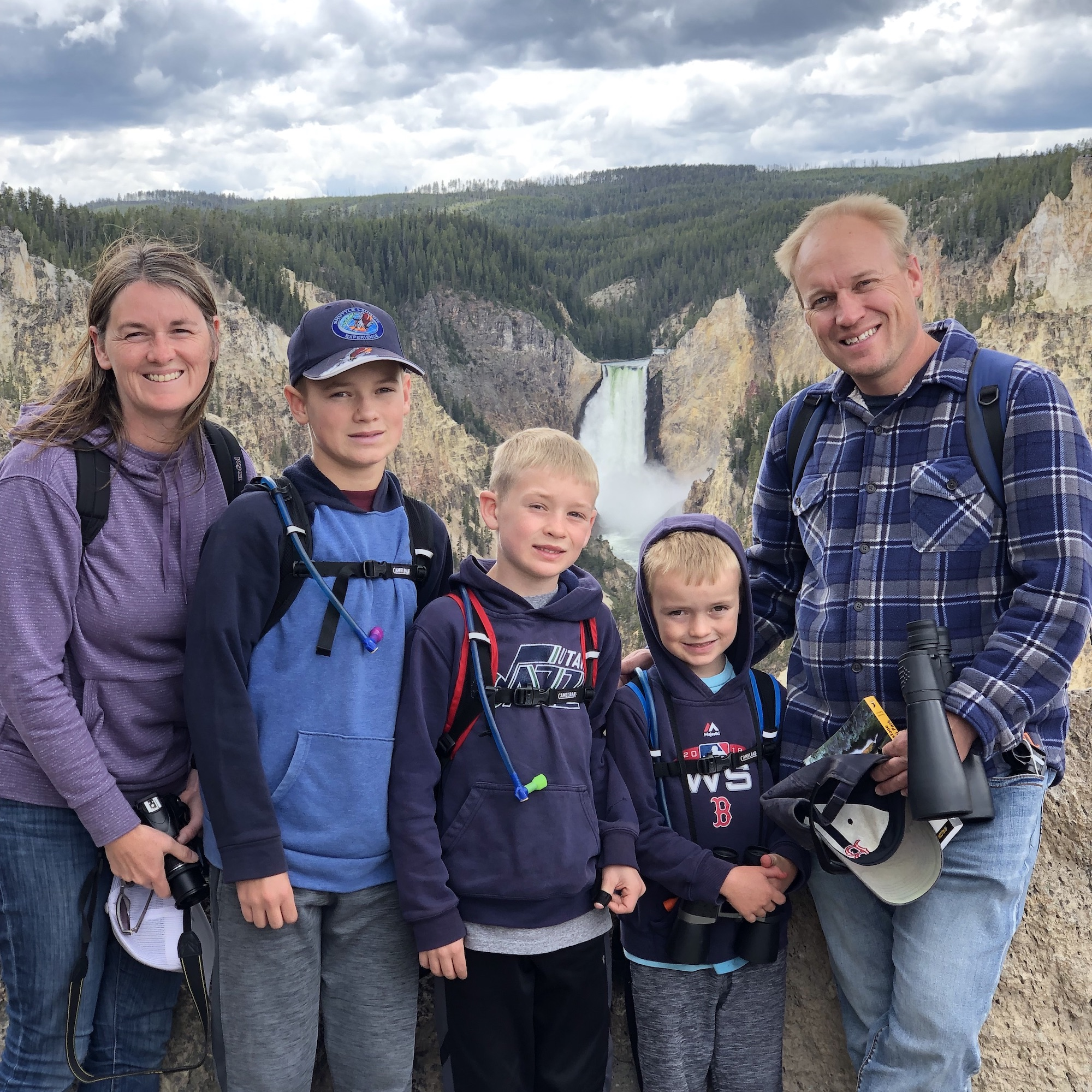 Family with Lower Falls and Grand Canyon of Yellowstone in background.