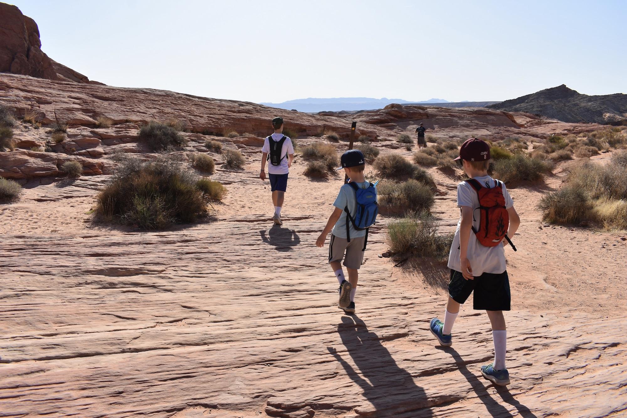 Children hiking on slick rock.