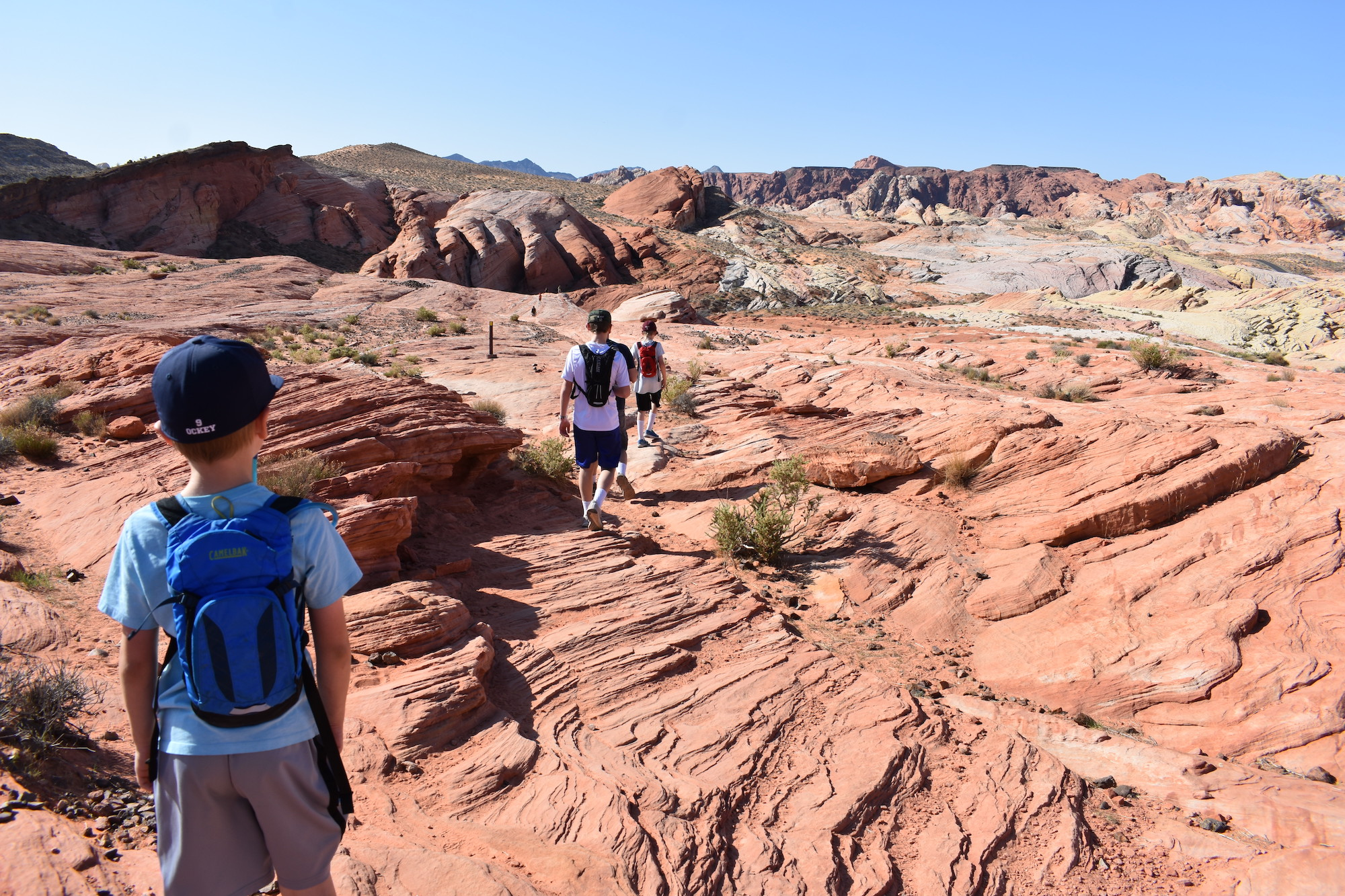 Hiking along slick rock to Fire Wave in Valley of Fire State Park